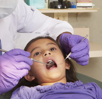 child in dental exam chair